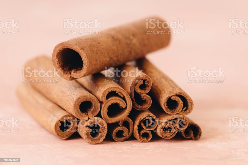 cinnamon sticks linked by a common thread stock photo