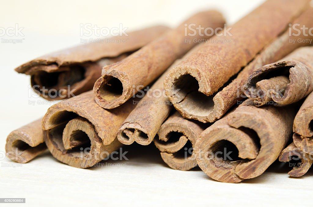 Cinnamon sticks putting on wood background stock photo