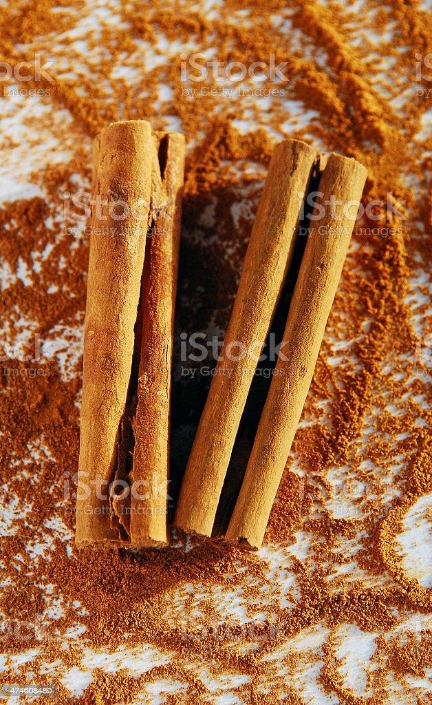 Cinnamon sticks with Powder on background stock photo