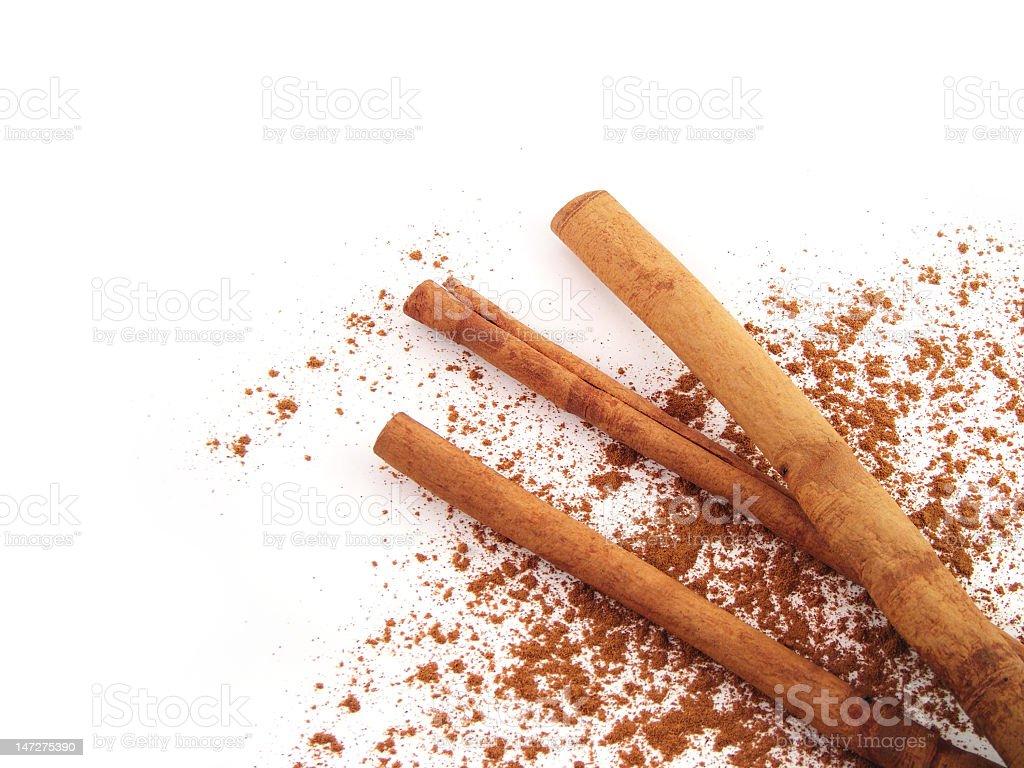 Cinnamon sticks with powder on white stock photo
