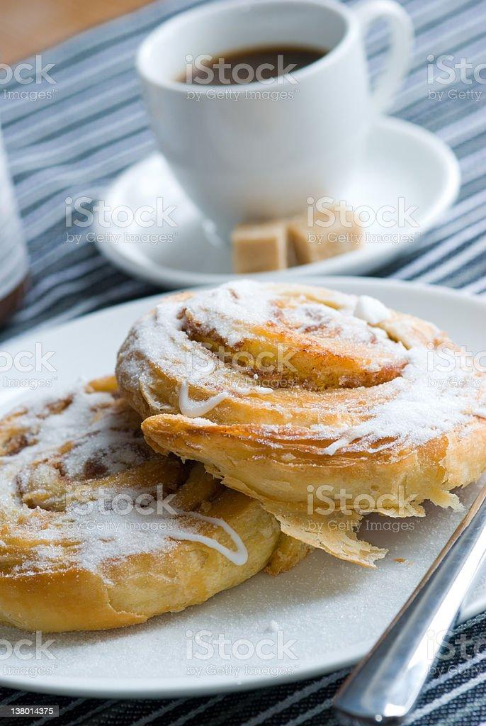 Cinnamon swirls with coffee stock photo