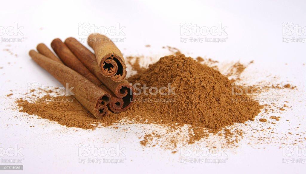 Cinnamon - three sticks and powder royalty-free stock photo