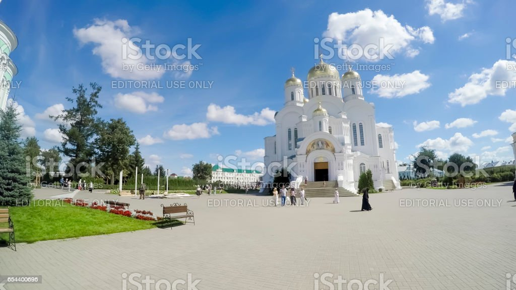 DIVEEVO, RUSSIA - circa AUGUST, 2016: Unknown pilgrims are on Cathedral Square near Savior Transfiguration Cathedral of the famous Holy Trinity Seraphim-Diveevo monastery in village of Diveevo, Russia stock photo