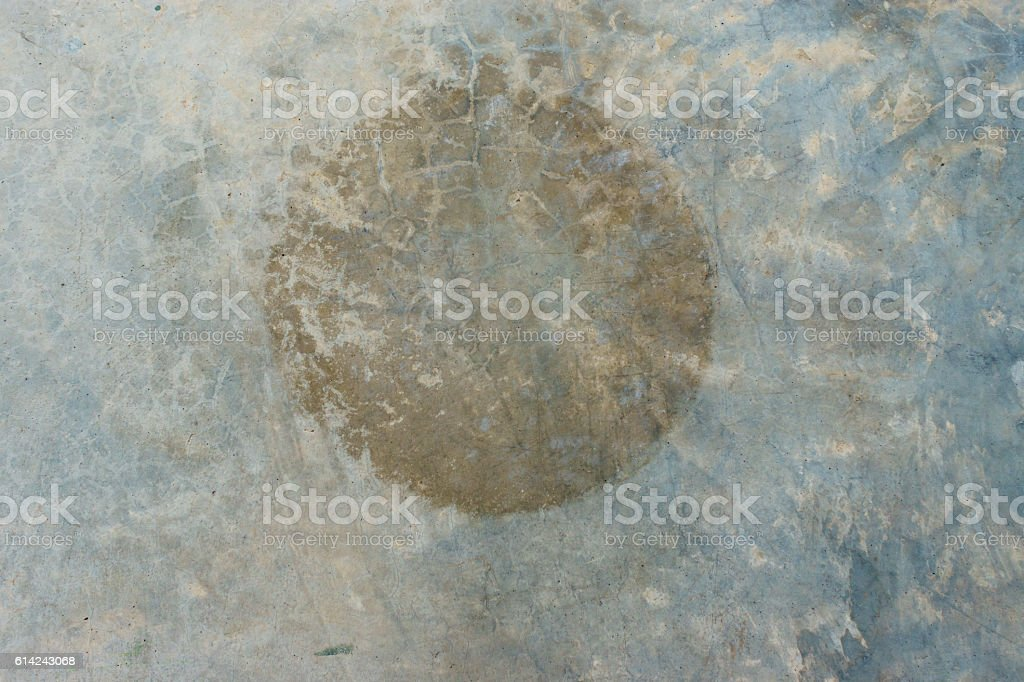 Circle brown rust stains on polished old grey concrete floor stock photo