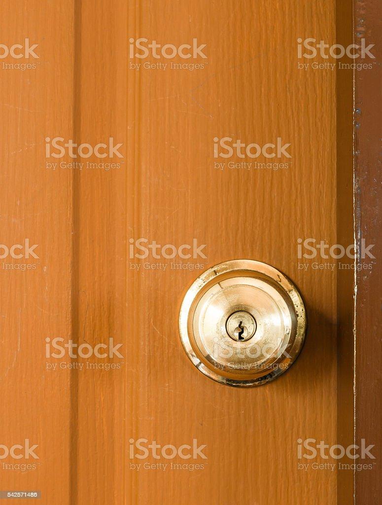 Circle door knob and  brown wood door. stock photo