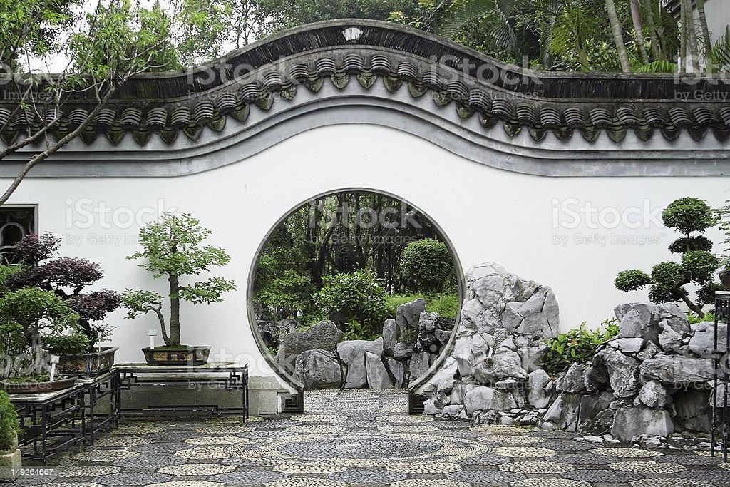 Circle entrance of Chinese garden in Hong Kong stock photo