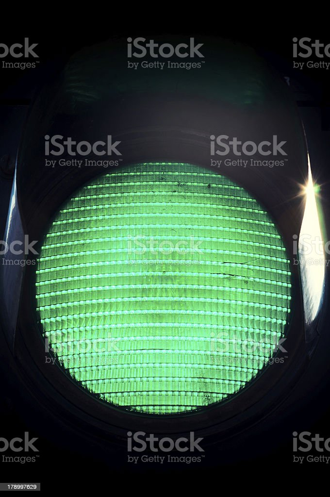 Circle green light with patterns against a black background stock photo