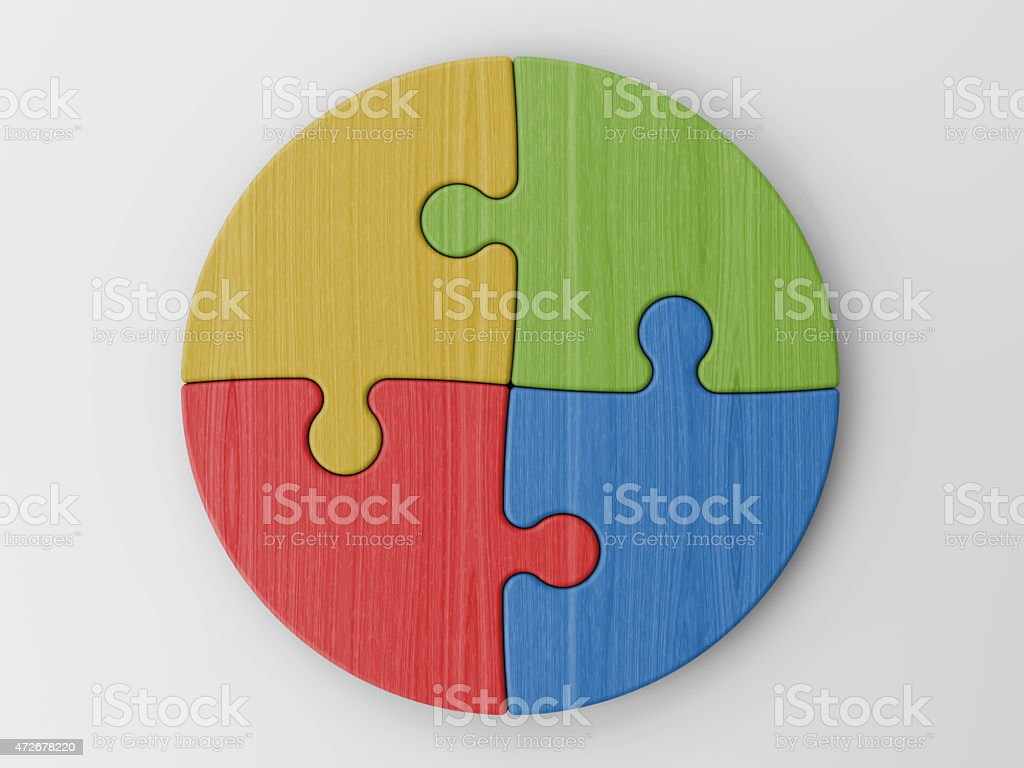 Circle made of four puzzle pieces of different colors stock photo