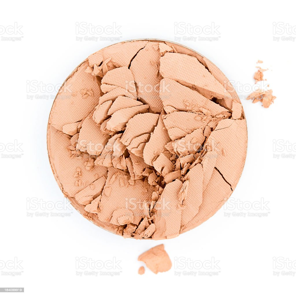 Circle of broken face powder on white background stock photo