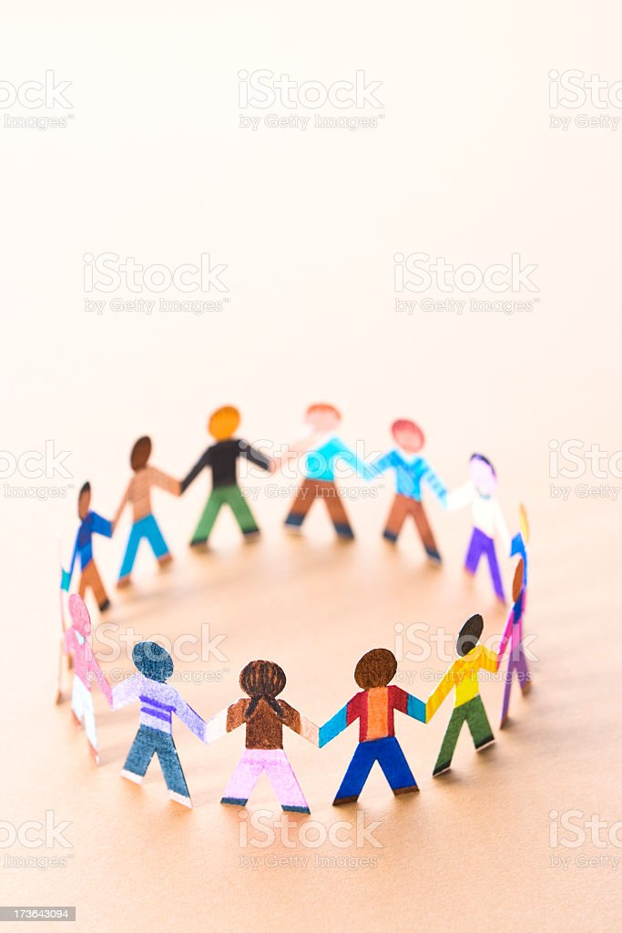 Circle of diverse children figurines holding hands royalty-free stock photo