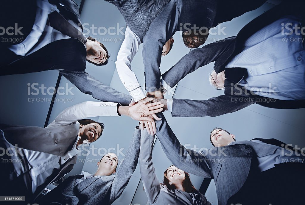 circle of   multi-ethnic business people holding hands royalty-free stock photo