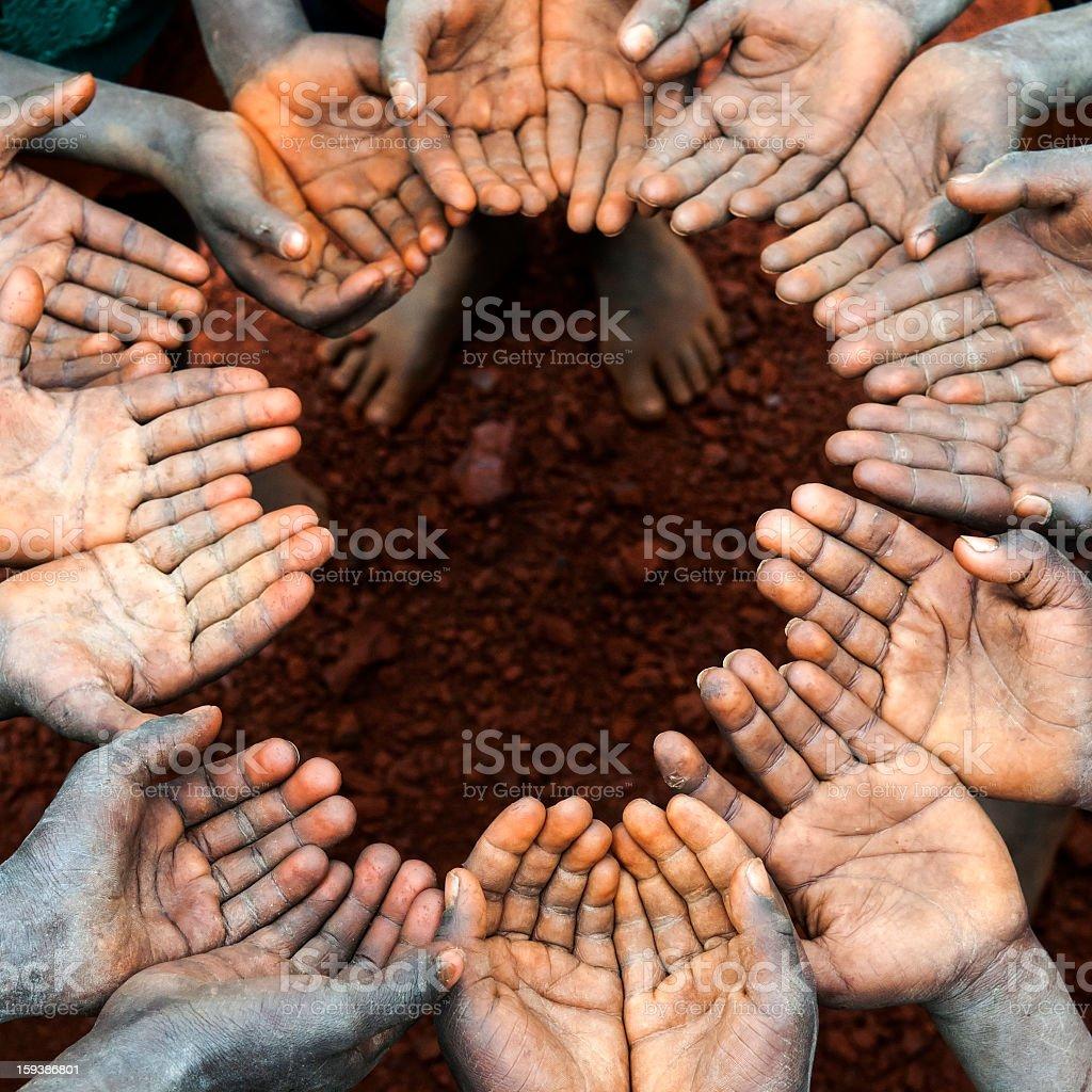 Circle of open children's hands in Africa stock photo