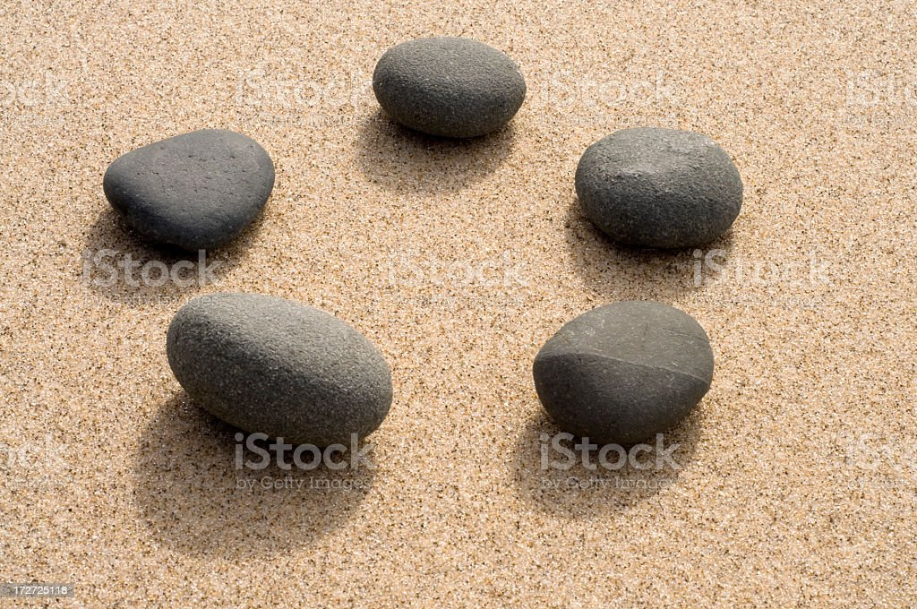 Circle of Pebbles on Sand royalty-free stock photo