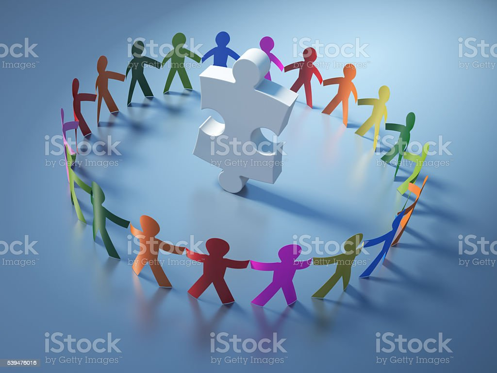 Circle of People with Jigsaw Piece stock photo