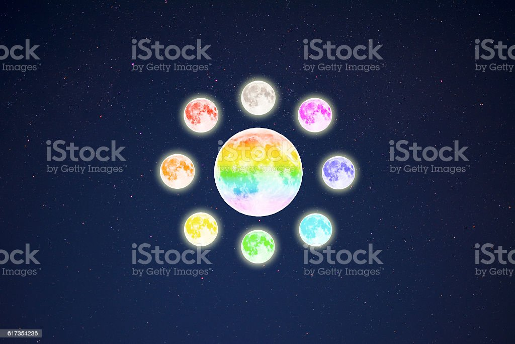 Circle of rainbow colored full moons on starry sky background stock photo