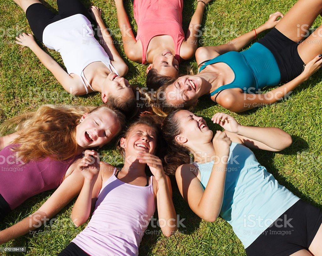 Circle of teenage girls stock photo