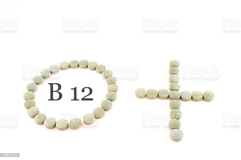Circle, plus sign and  spirulina pills stock photo