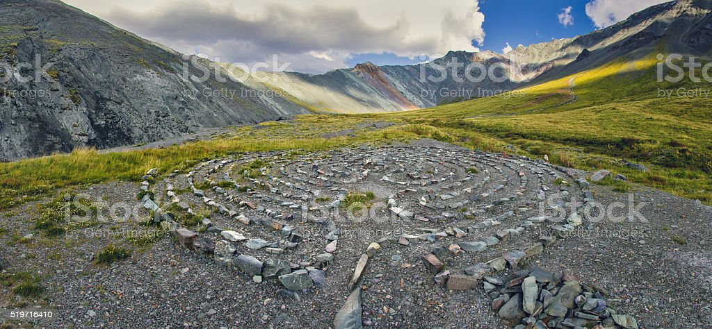 Circles of stones in the mountains stock photo