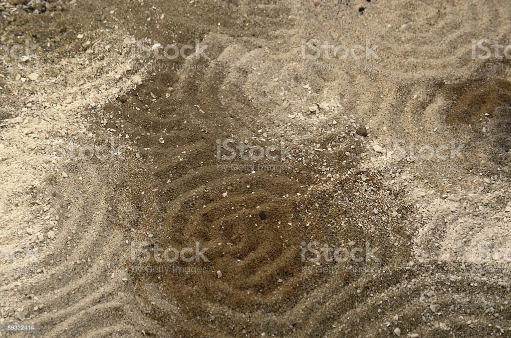 circles on multitoned brown sand surface royalty-free stock photo