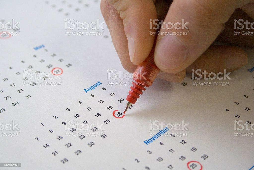 Circling calendar dates stock photo