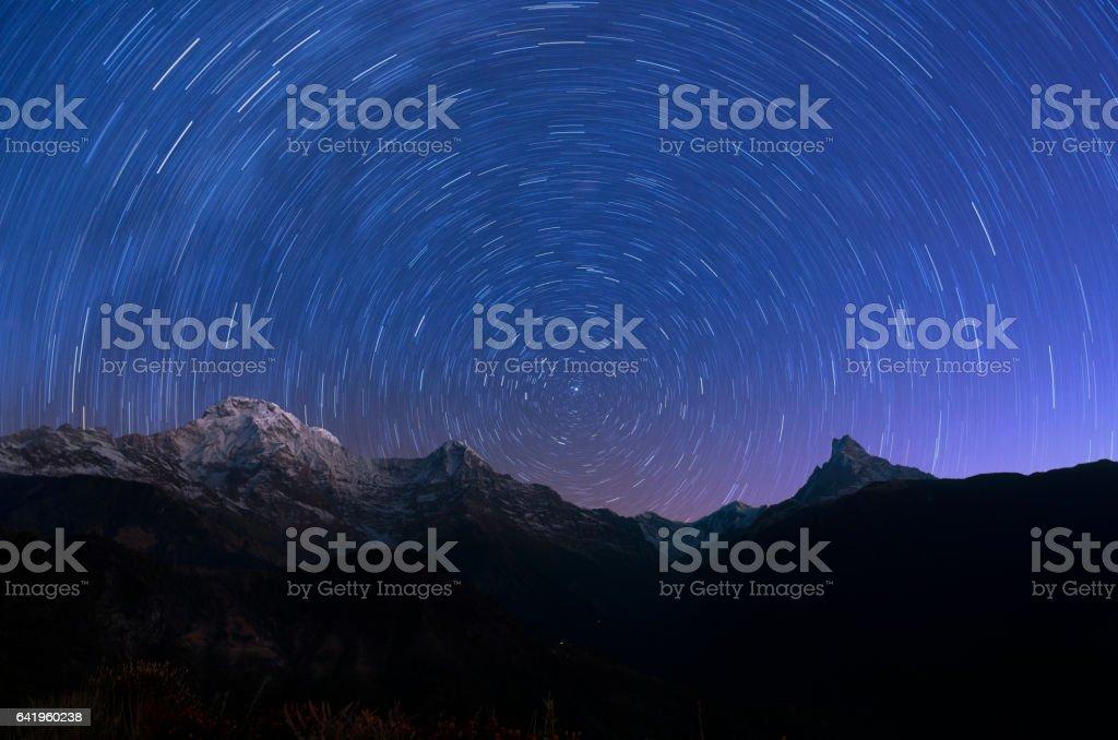 Circling stars and mountain stock photo