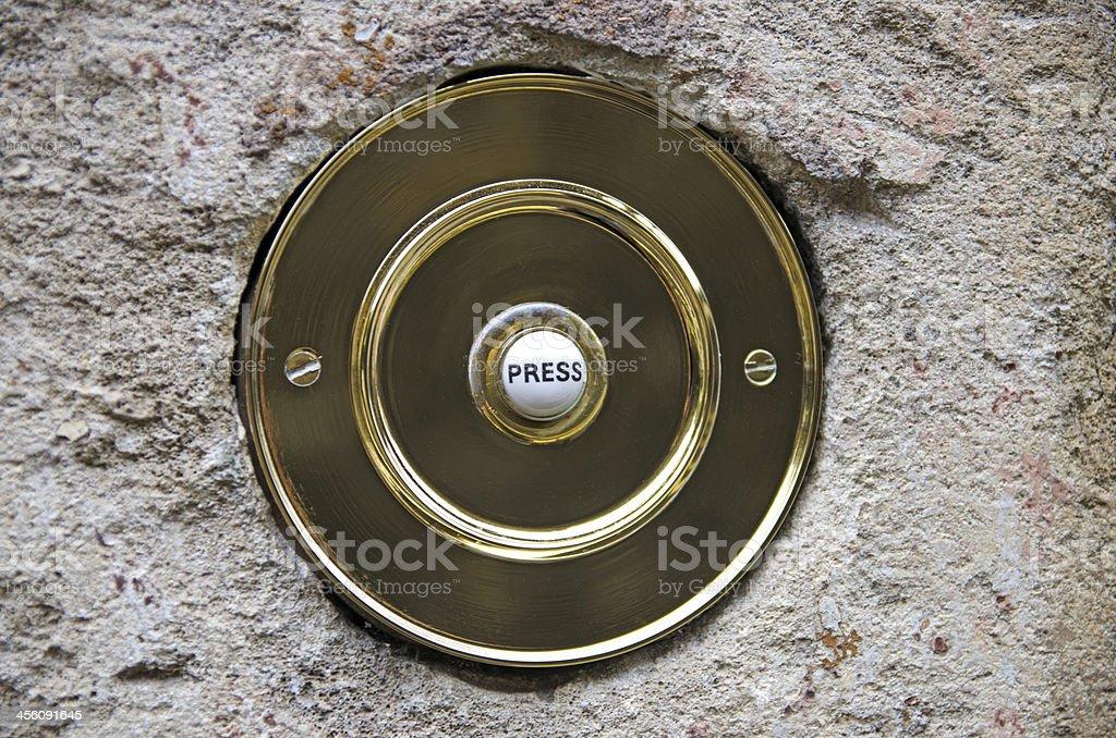 Circlular brass doorbell stock photo