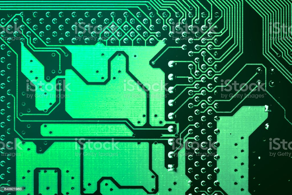 Circuit board. Electronic computer hardware technology. Motherboard digital chip. Tech science background. Integrated communication processor. Information engineering component. Green color. stock photo