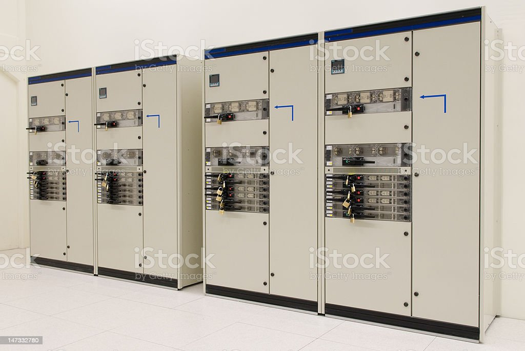 Circuit breakers on two switch cabinets royalty-free stock photo
