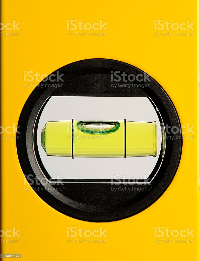 Circular bubble level on a yellow background stock photo