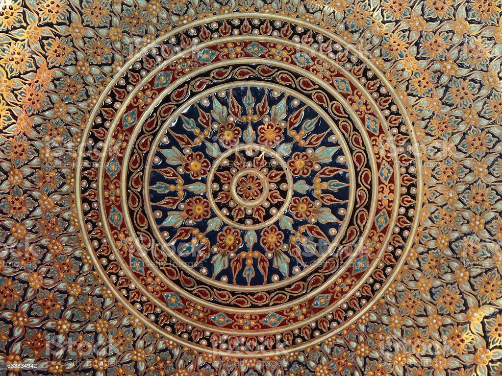 Circular ceramic pattern background on wall stock photo