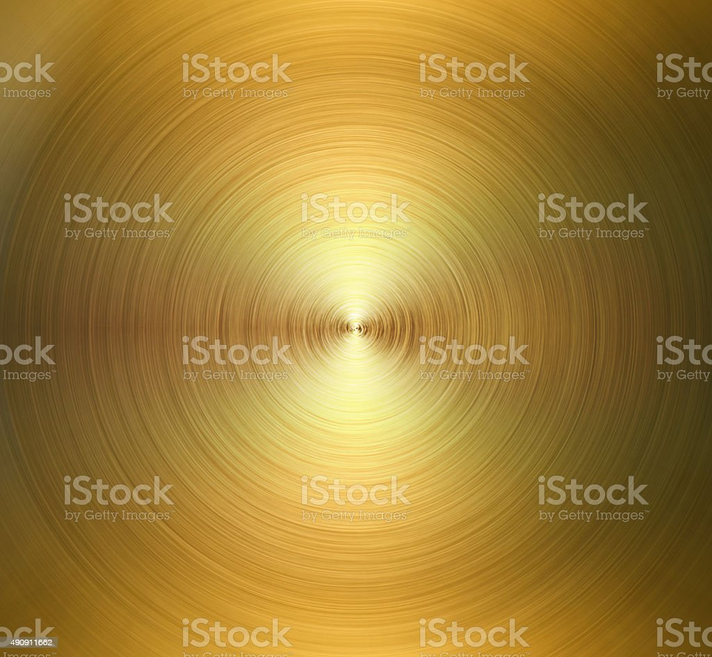 Circular polished steel texture. Golden shiny background stock photo
