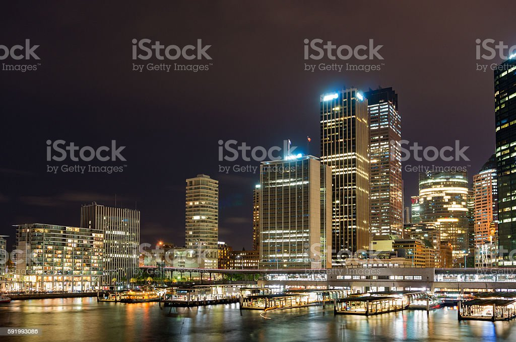 Circular Quay ferry and railway station with skyline at night stock photo