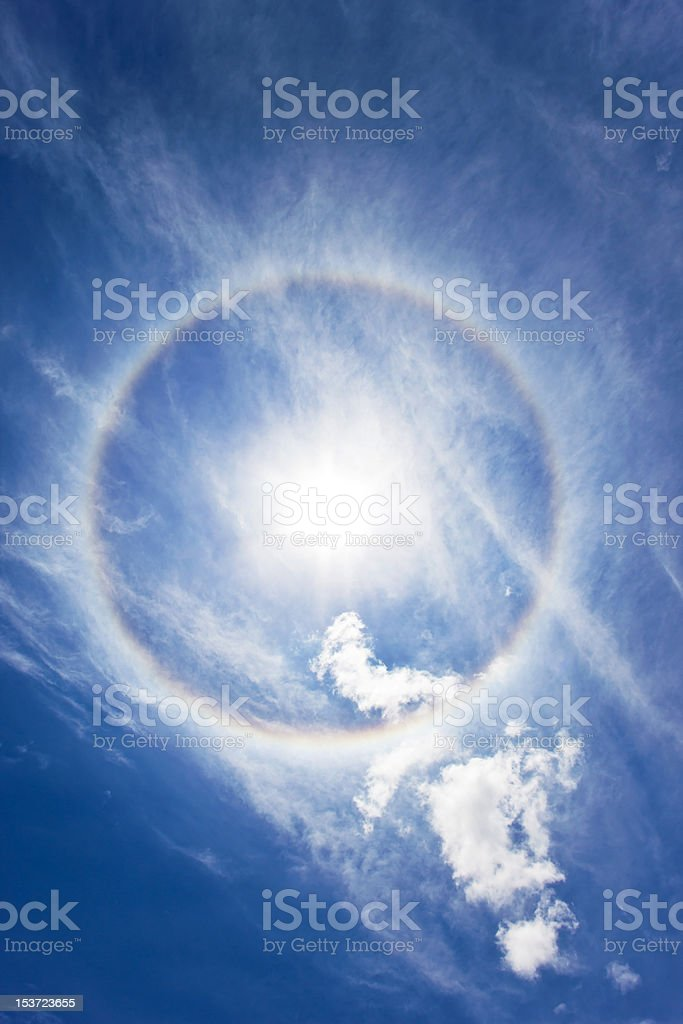 circular rainbow around sun stock photo