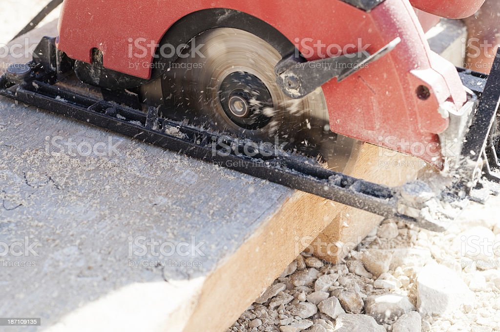 Circular saw at work on a construction site stock photo