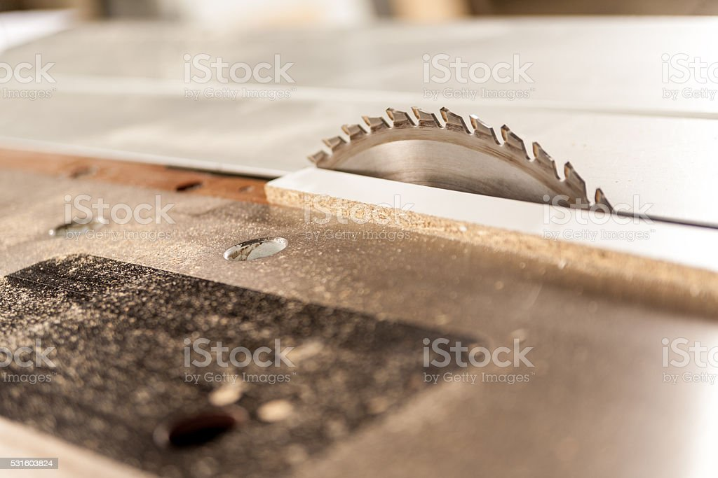 circular saw covered with sawdust stock photo