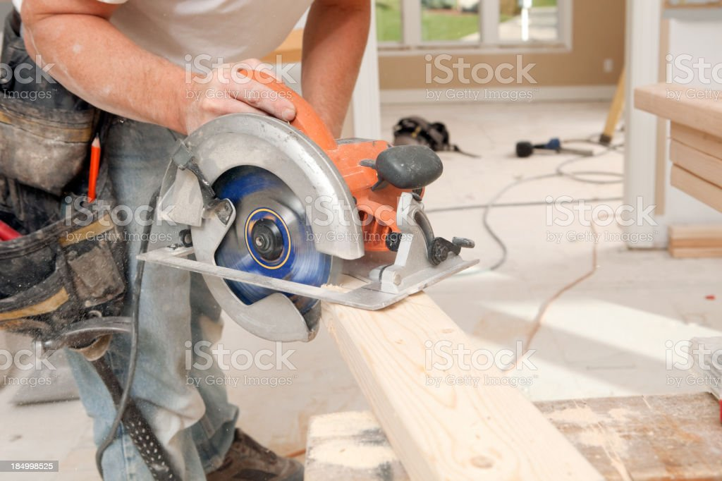 Circular Saw Cuts Stud for Home Remodeling Project stock photo