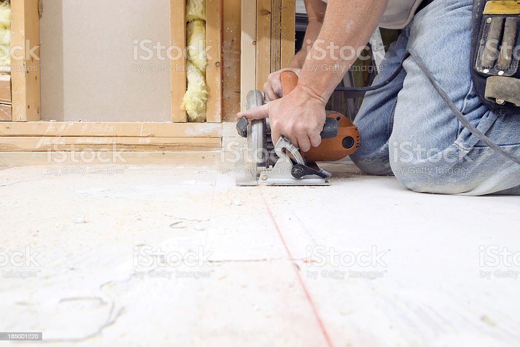 Circular Saw Cutting Subfloor for House Remodeling Project stock photo