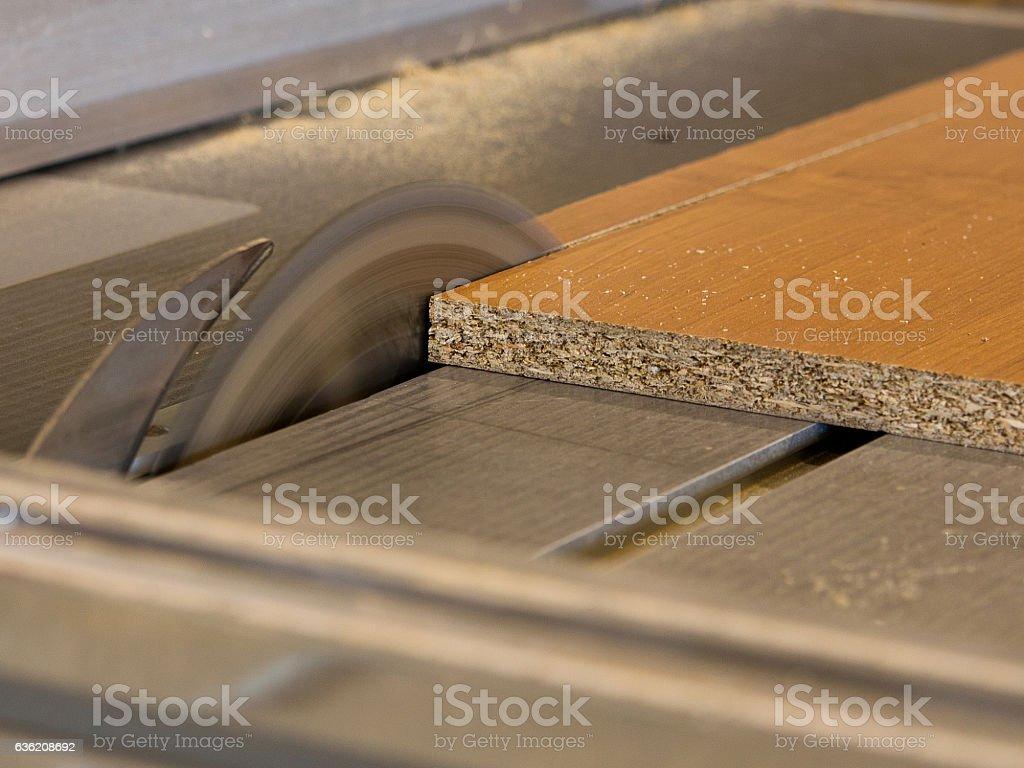 Circular saw cutting wood board stock photo
