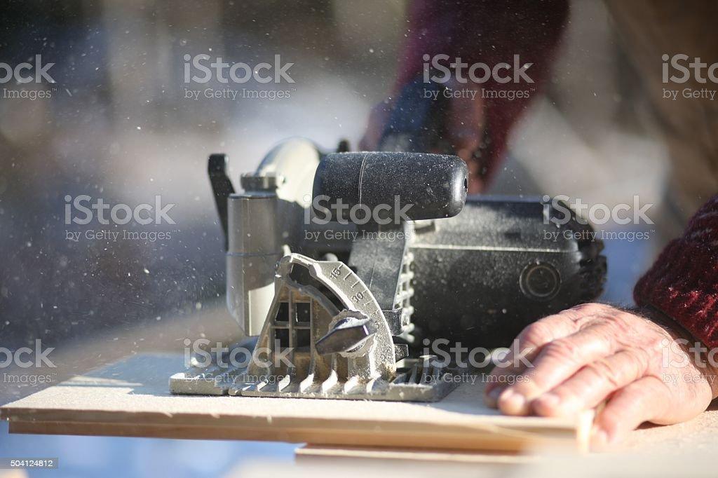 Circular saw cutting wood stock photo