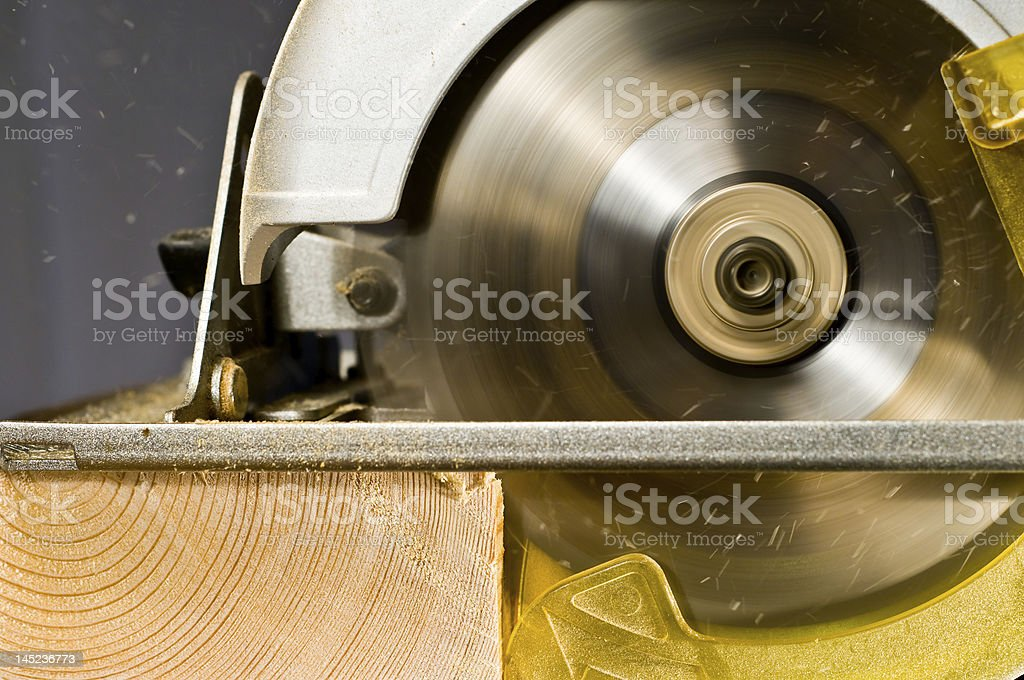Circular saw in action royalty-free stock photo