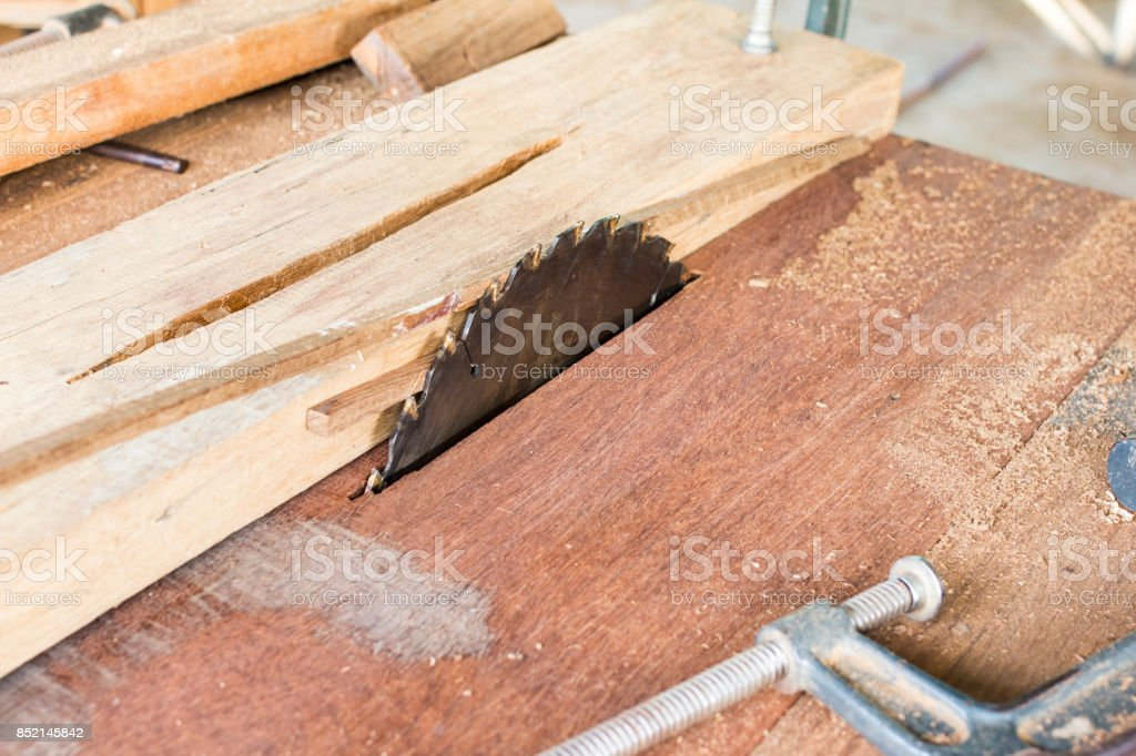Circular saw in the workshop of a carpenter with a sliver dirty. stock photo