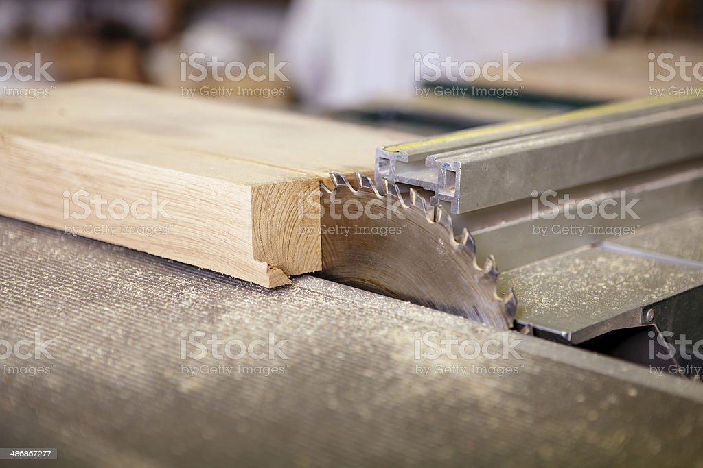 Circular saw sliced €‹into a piece of wood stock photo