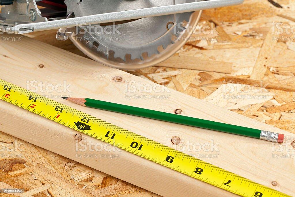 Circular Saw Tape Measure and Wood stock photo