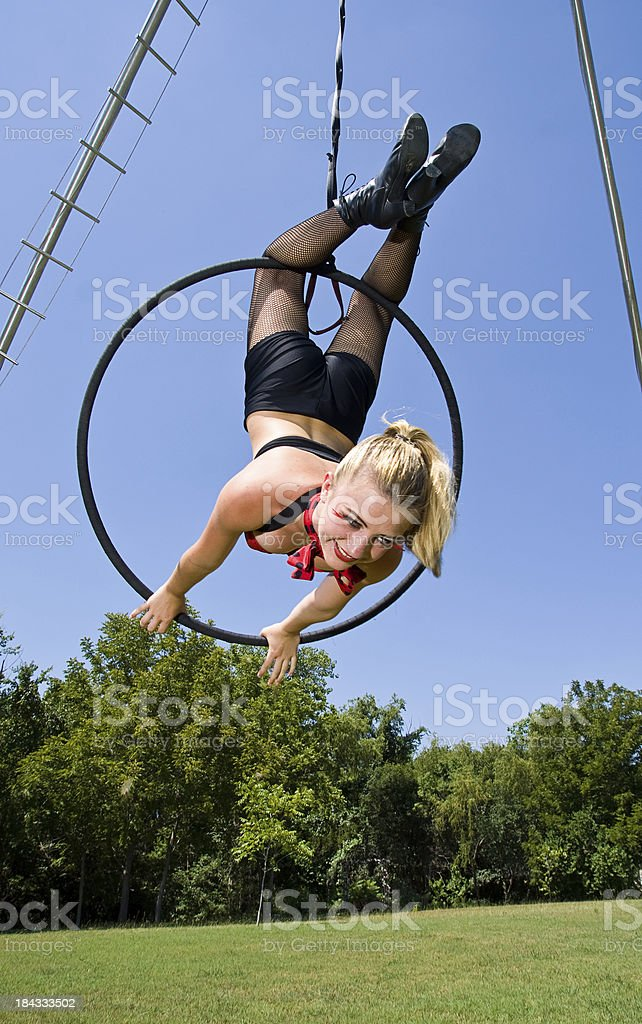 Circus Acrobat Hanging Upsidedown stock photo