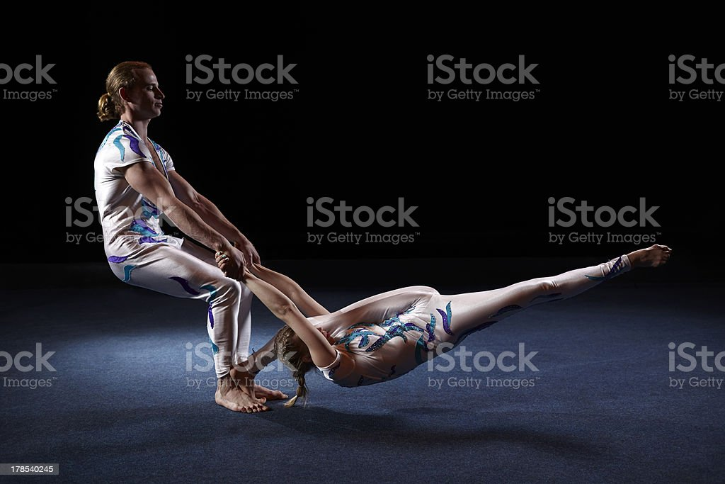Circus artists perform different tricks. stock photo