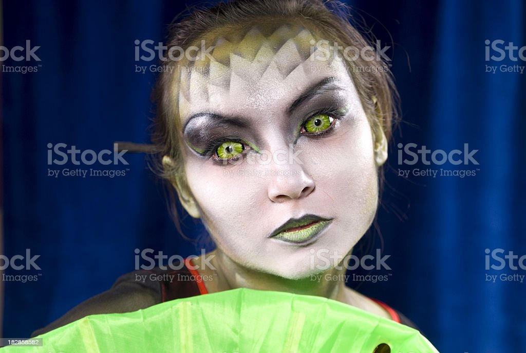 Circus Futuristic Woman Face & Contact Eye Lenses, Geisha & Stage Makeup stock photo