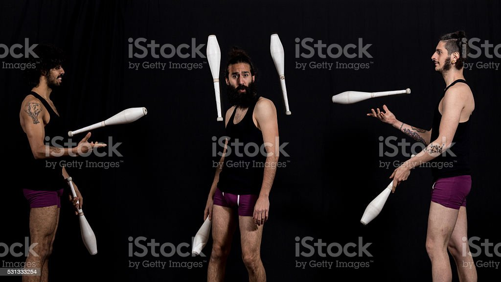 Circus jugglers during their batons performance stock photo