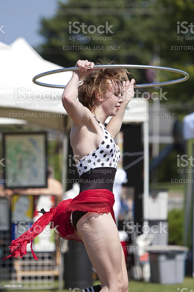 Circus Performer Does Hula Hoop At Spring Festival royalty-free stock photo