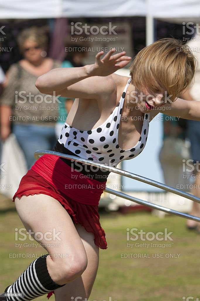 Circus Performer Works Hula Hoop At Outdoor Festival royalty-free stock photo