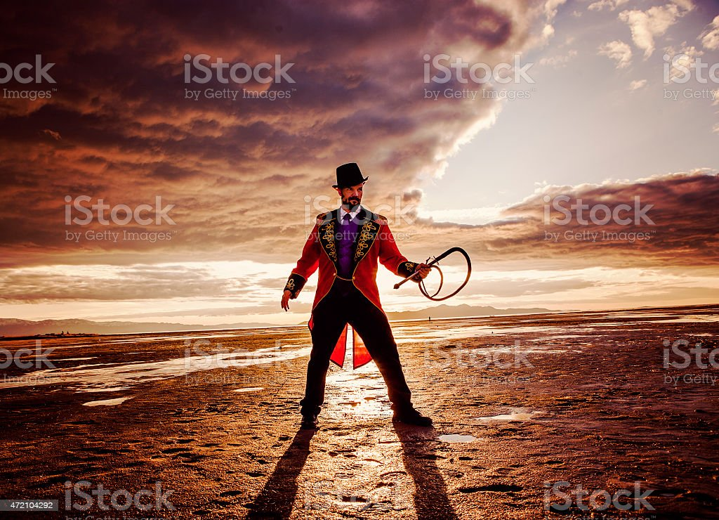 Circus Ring Master in a Dramatic Desert Setting stock photo